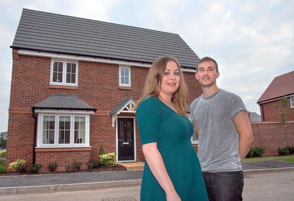 Adam and Hannah outsdie their new Bovis Home