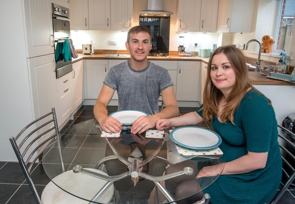 Adam and Hannah enjoying the kitchen in their new Bovis Home