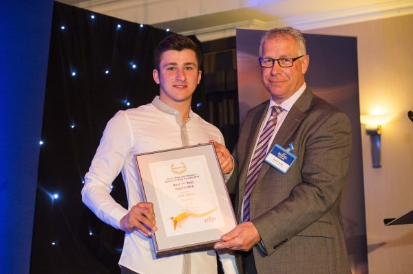 Jake Harris recieving his apprentice award