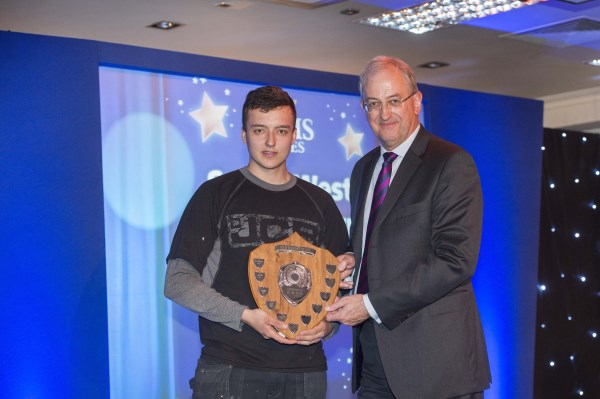 Jake Pulman recieving his award from Managing Director, Malcolm Pink