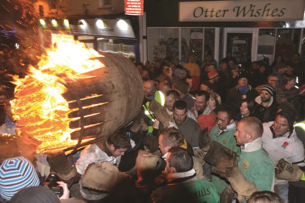 Lighting the tar barrels in Ottery St Mary
