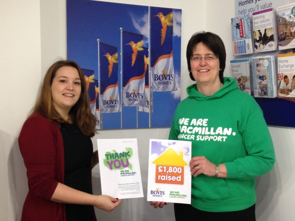 Bovis Homes handing over £1800 to macmillan cancer support