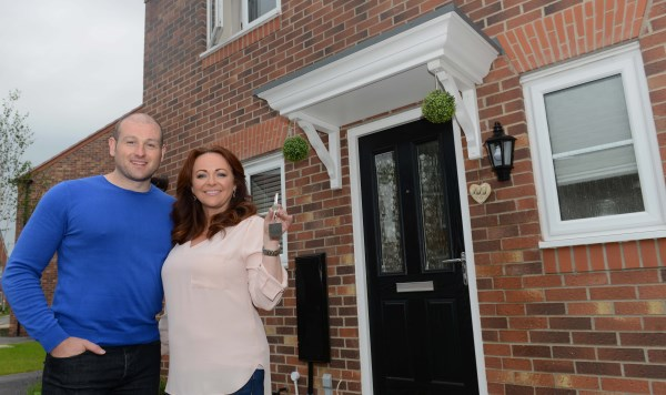 Richard Humpherson and Angela Proctor ourside their first home