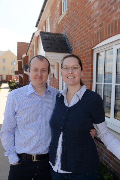 Simon and Fredericke outside their new Bovis Home at Abbotswood in Romsey
