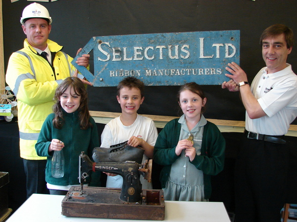 Museum curator Robert Worrall with local children