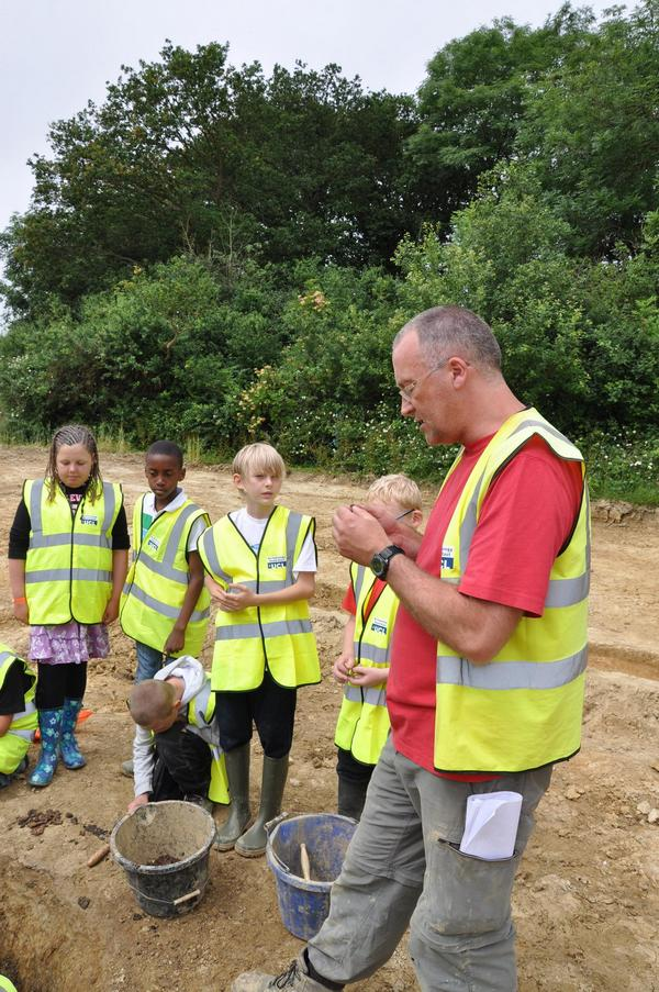 Simon Stevens, archaeologist with pupils at southwater dig
