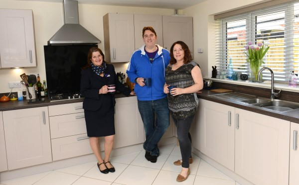Nigel and Catherine Tijou with Bovis Homes sales advisor Kerry