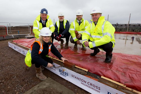 Image for History in the making as house building gets under way at Stanton Cross with first brick laid