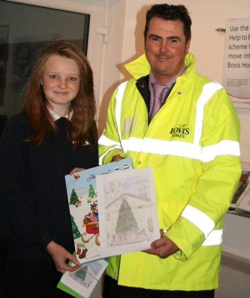 Competition winner Natasha Knight awarded her prize by site manager of Windmill View Colin Macleod